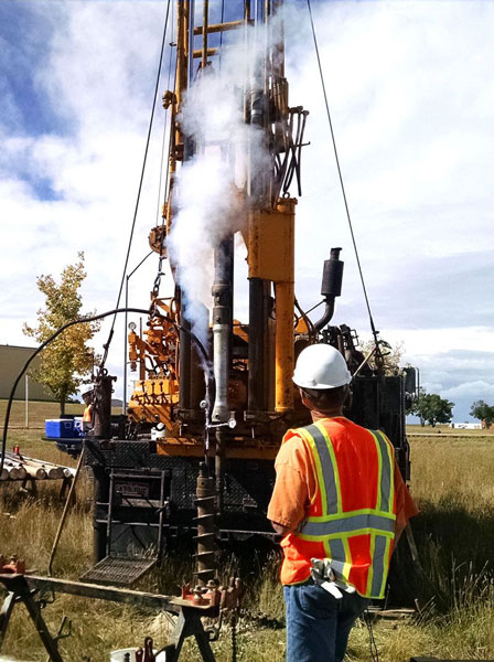 cyrogenic core drilling in action with man watching